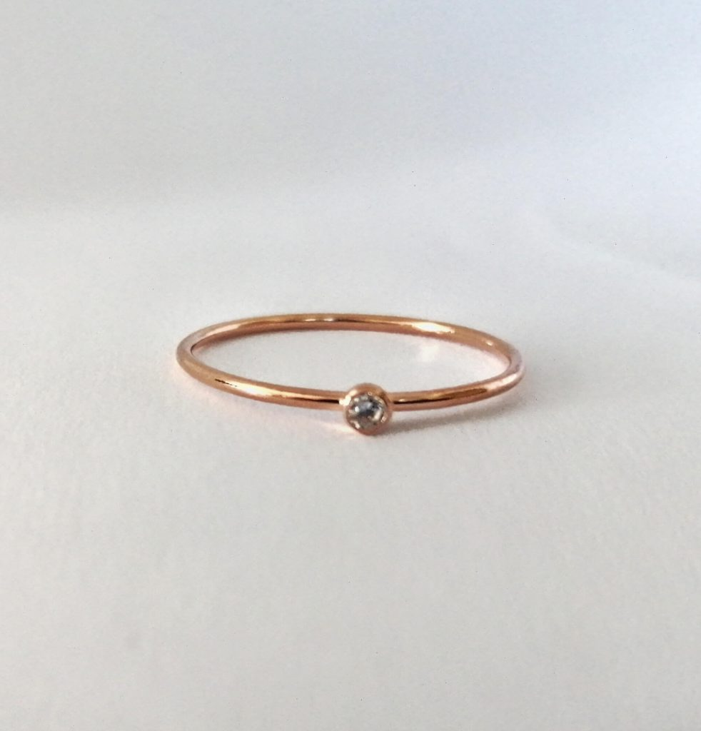 tiny diamond ring in 9 carat rose gold