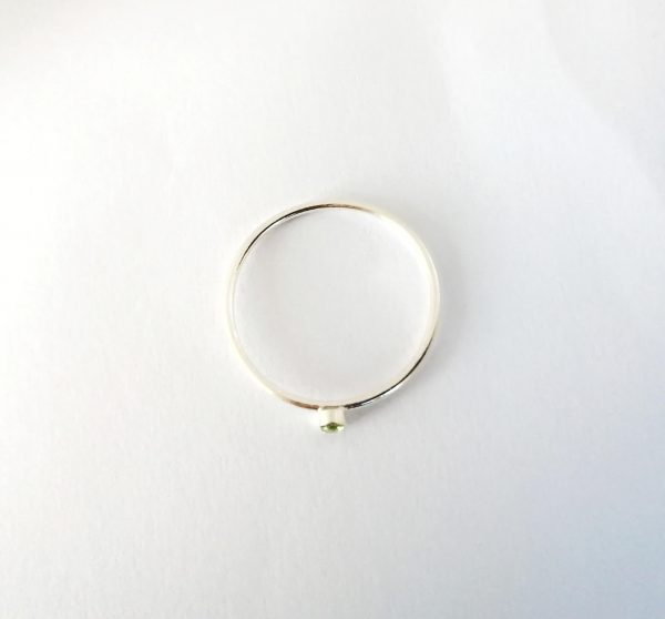 top view of tiny silver stacking ring