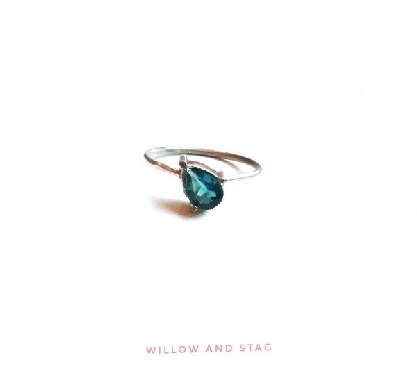 offset blue topaz pear cut silver ring